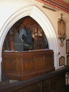The old organ loft in the chancel, showing some of the Choir Organ pipes